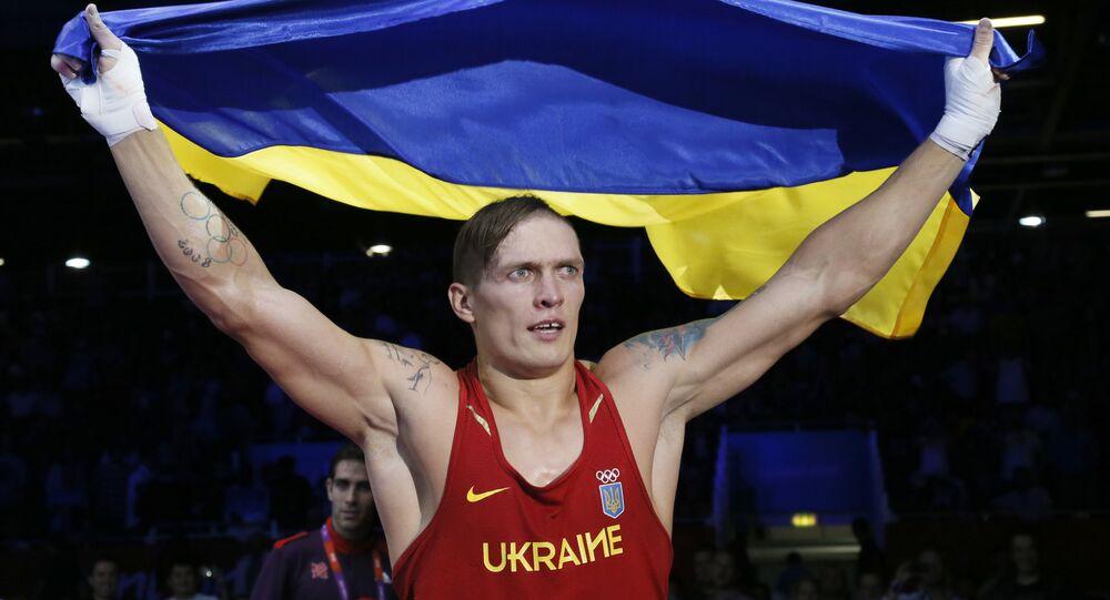 Oleksandr Usyk of the Ukraine waves the Ukrainian national flag