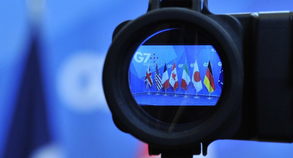 Flags are seen in a camera screen at the G7 summit