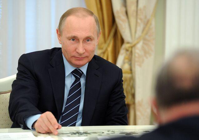 Russian President Vladimir Putin meets with French Senate President Gerard Larcher