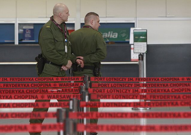 Border Guards patrol at Warsaw's Frederic Chopin airport in Warsaw.