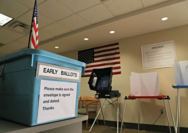 An example of an early ballot collection box and demonstration of voting areas is set up at the Maricopa County Recorder's office in Phoenix.