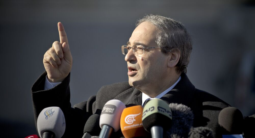Syrian Deputy Foreign Minister Faisal Mekdad gestures as he talks to journalists after a meeting with the Syrian opposition at the United Nations headquarters in Geneva, Switzerland (File)