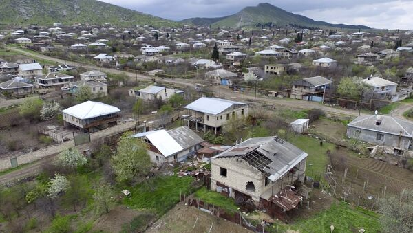 This aerial view shows destroyed houses during the fighting at Martakert province in the region of Nagorno-Karabakh, Azerbaijan, Monday, April 4, 2016 - Sputnik International