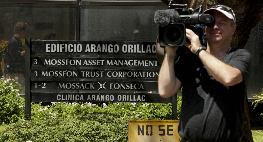 A cameraman films outside the Arango Orillac Building that lists the Mossack Fonseca law firm in Panama City, Tuesday, April 5, 2016