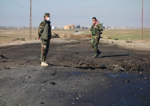 Kurdish soldiers survey the site of a bomb attack on a road between Mosul, Iraq, and the Syrian border in northern Iraq (File)