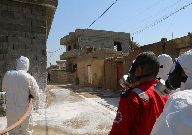 Members of the civil defence spray and clean areas in the town of Taza, around 220 kilometres north of the capital Baghdad, on March 13, 2016, that might have been contaminated in a chemical attack carried out by the Islamic State (IS) group the previous week