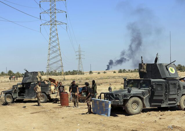 Smoke rises from Daesh positions after a US-led coalition airstrike as Iraqi Security forces surround the town of Hit, 85 miles (140 kilometers) west of Baghdad, Iraq. file photo