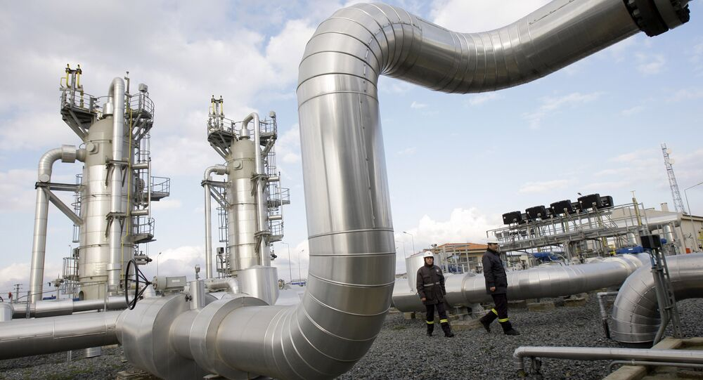 Turkish technicians walk at the Silivri natural gas storage facility in Silivri, near Istanbul, Turkey.