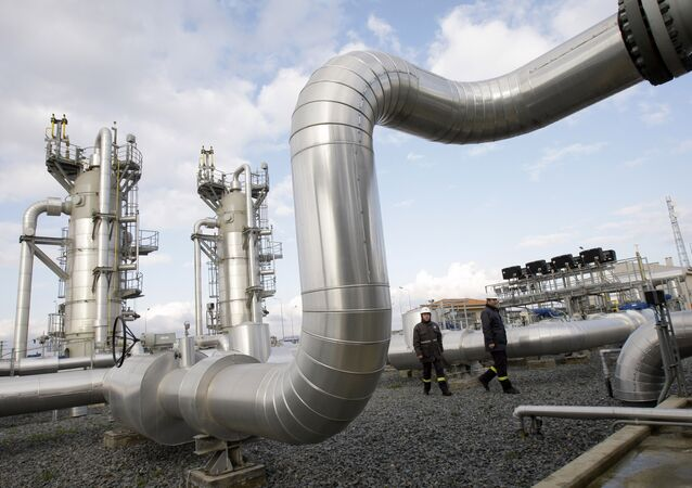 Turkish technicians walk at the Silivri natural gas storage facility in Silivri, near Istanbul, Turkey, Wednesday, Jan. 7, 2009