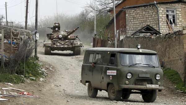 A tank of the self-defense army of Nagorno-Karabakh moves on the road in the village of Talish April 6, 2016 - Sputnik International