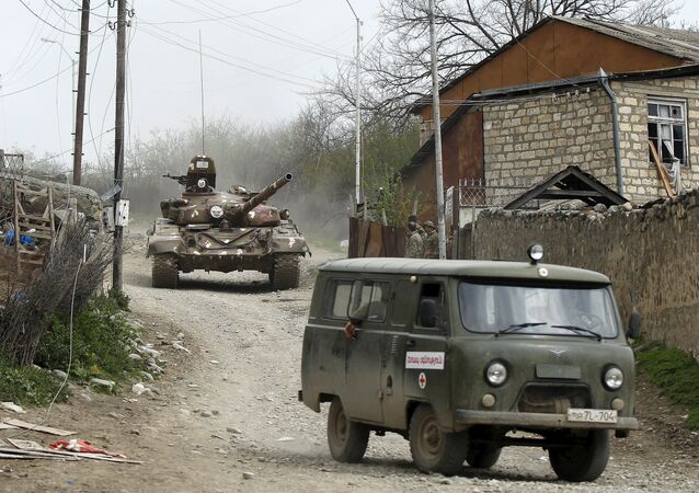 A tank of the self-defense army of Nagorno-Karabakh moves on the road in the village of Talish April 6, 2016