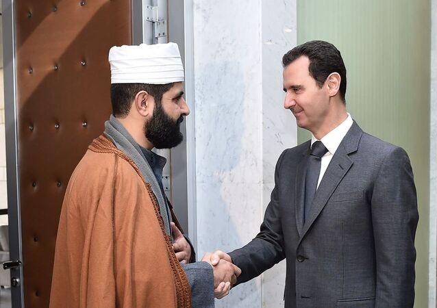 Sheikh Ahmad Bilal meeting with Syrian President Bashar Assad, file photo.