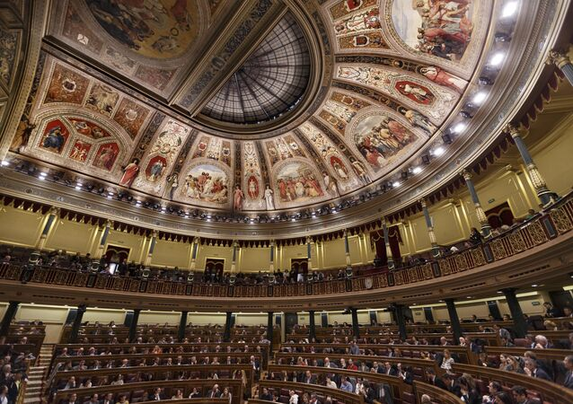 Newly-elected lawmakers sit on the Spanish Parliament in Madrid, Spain, Wednesday, Jan. 13, 2016