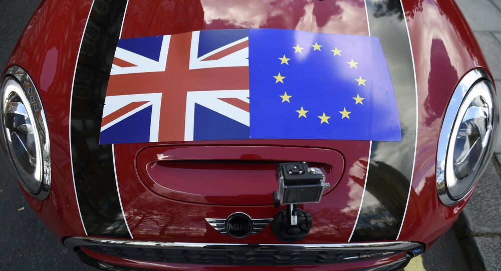 A Mini car is seen with a Union flag and European Union flag design on its bonnet in London, Britain March 31, 2016