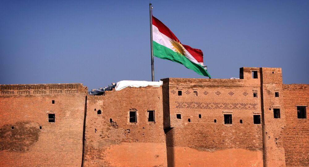A picture taken on February 3, 2016, shows the Kurdish flag flying over the Arbil Citadel, in the capital of the autonomous Kurdish region of northern Iraq