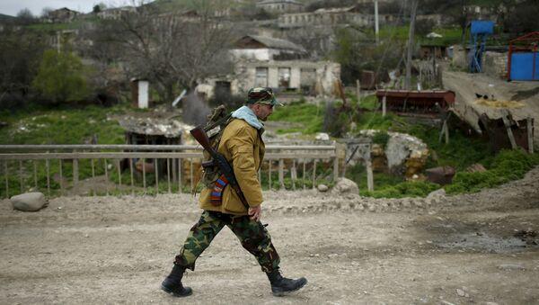 A volunteer walks on a road in the Nagorno-Karabakh's village of Talish April 6, 2016 - Sputnik International