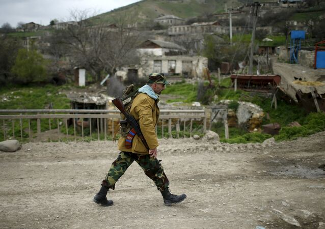 A volunteer walks on a road in the Nagorno-Karabakh's village of Talish April 6, 2016