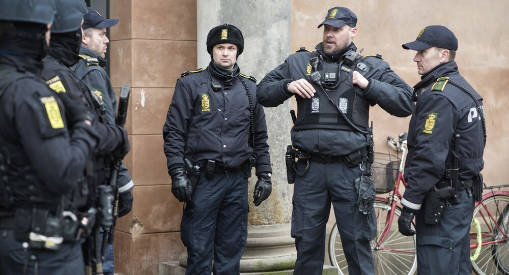 Danish policemen stand guard in front of the city court in Copenhagen, Denmark