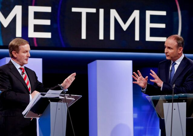 Irish Prime Minister and Fine Gael leader Enda Kenny (L) and Fianna Fail party leader Micheal Martin participate in the final televised leaders' debate in Dublin on February 23, 2016,