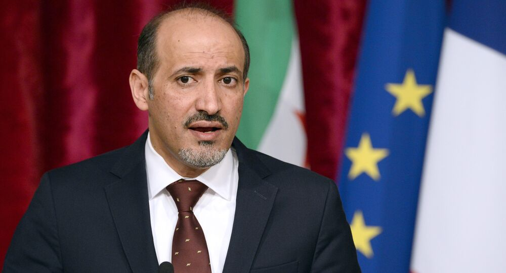 Syrian National Coalition (SNC) leader Ahmad Jarba speaks during a press conference following a meeting with French President at the Elysee palace in Paris on May 20, 2014