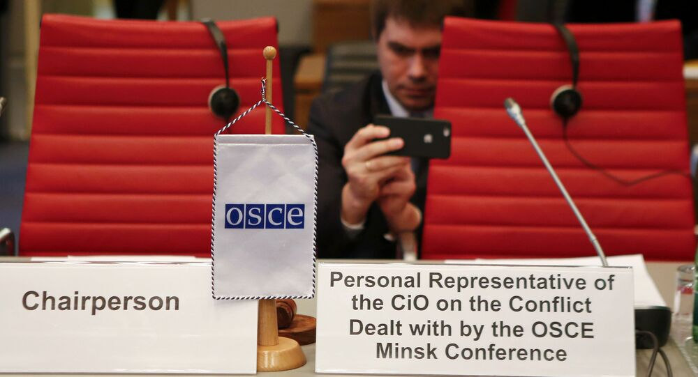 Diplomats wait for the start of a meeting of the permanent council of the OSCE, the Organization for Security and Cooperation in Europe, on Nagorno-Karabakh in Vienna, Austria, April 5, 2016