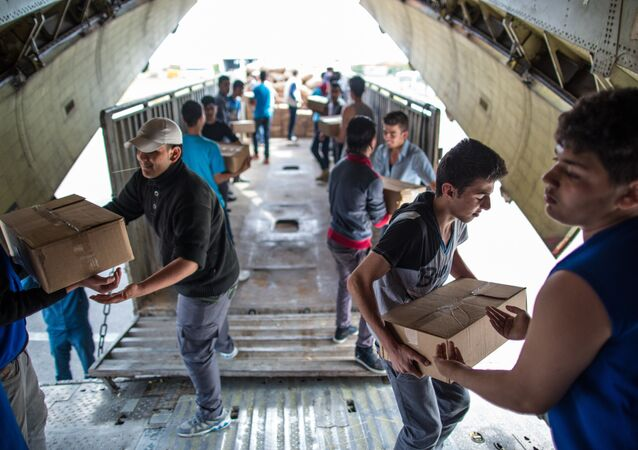Unloading Russian EMERCOM plane with humanitarian aid which arrived to Latakia Airport in Syria.