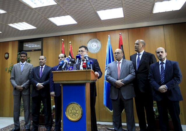 Libyan prime minister-designate under a proposed National Unity government Fayez Seraj (C) attends a news conference in Tripoli, Libya, March 30, 2016