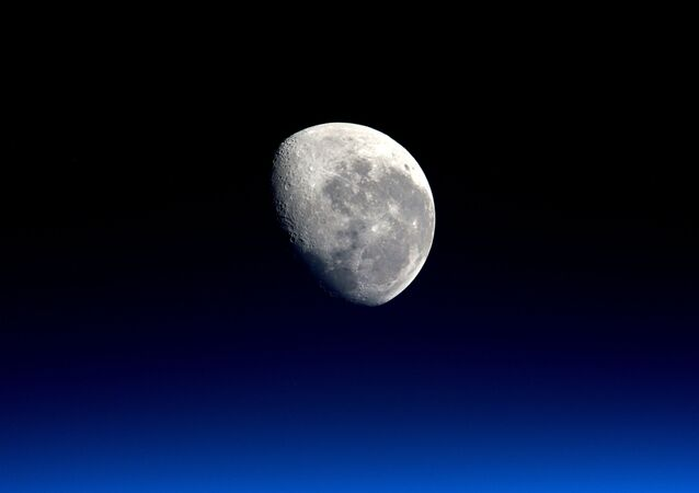 The setting moon is seen in a photograph taken by Expedition 47 Flight Engineer Tim Peake of the European Space Agency (ESA) from the International Space Station on 28 March 2016 and released by NASA on 4 April 2016.