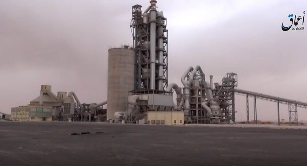 This image made from video published online by Amaq News Agency of the Islamic State group shows a cement factory where in a brazen assault near the Syrian capital, Islamic State militants snatched up to 300 cement workers and contractors from their workplace northeast of Damascus Thursday, April 7, 2016