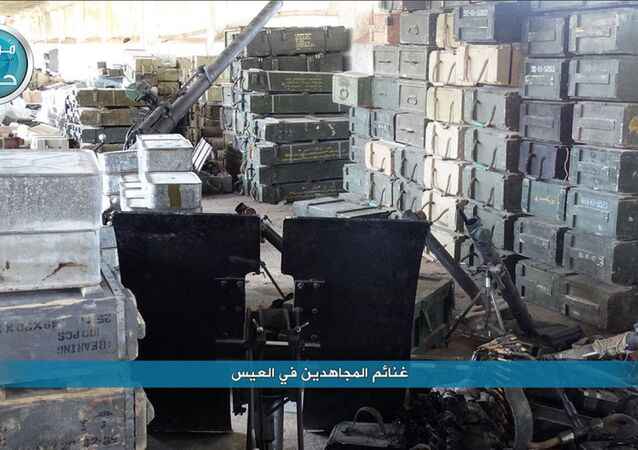 This image posted on the Twitter page of Syria's al-Qaida-linked Nusra Front on Saturday, April 2, 2016, shows boxes of ammunition and weapons captured by Nusra Front during the militants attack on the northern village of al-Ais in Aleppo province, Syria