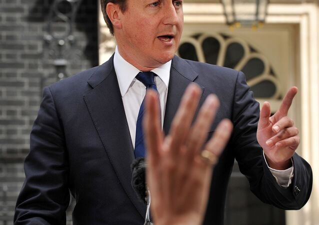 Britain's Prime Minister David Cameron addresses the media outside 10 Downing Street in London.