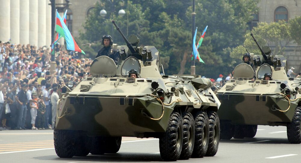Azeri armoured personnel carriers drive through the center of Baku as part of a military parade in honor of Armed Forces Day on June 26, 2008