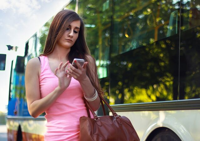 A young woman using her smartphone