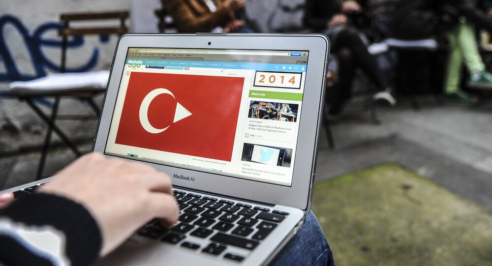 A person uses a laptop computer showing a Turkish flag on March 27, 2014 in Istanbul
