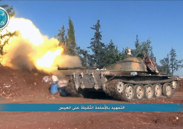 This image posted on the Twitter page of Syria's al-Qaida-linked Nusra Front on Friday, April 1, 2016, shows a Nusra Front tank firing at Syrian troops and pro-government gunmen in the northern village of al-Ais in Aleppo province, Syria