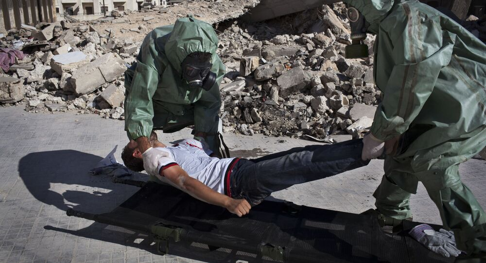 Volunteers take part in a simulation of how to respond to a chemical attack, in the northern Syrian city of Aleppo (File)