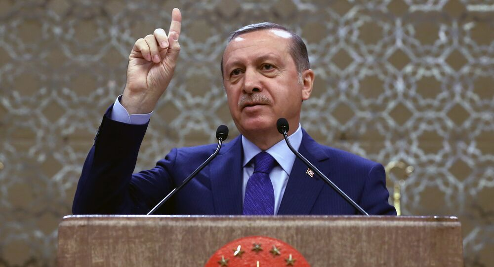 Turkish President Recep Tayyip Erdogan addresses a meeting of local administrators in Ankara, Turkey, Wednesday, April 6, 2016