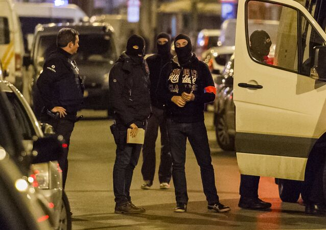 Police investigate an area where terror suspect Mohamed Abrini was arrested earlier today, in Brussels on Friday April 8, 2016