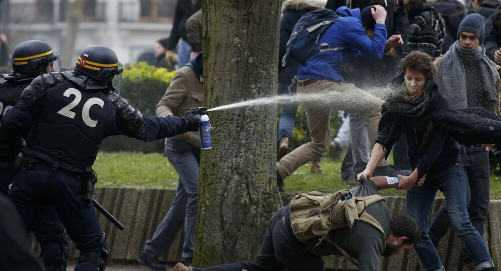French gendarmes use tear gas during clashes with youths during a demonstration by employees, high school and university students against the French labour law proposal in Lille, France, as part of nationwide labor reform protests and strikes, March 31, 2016