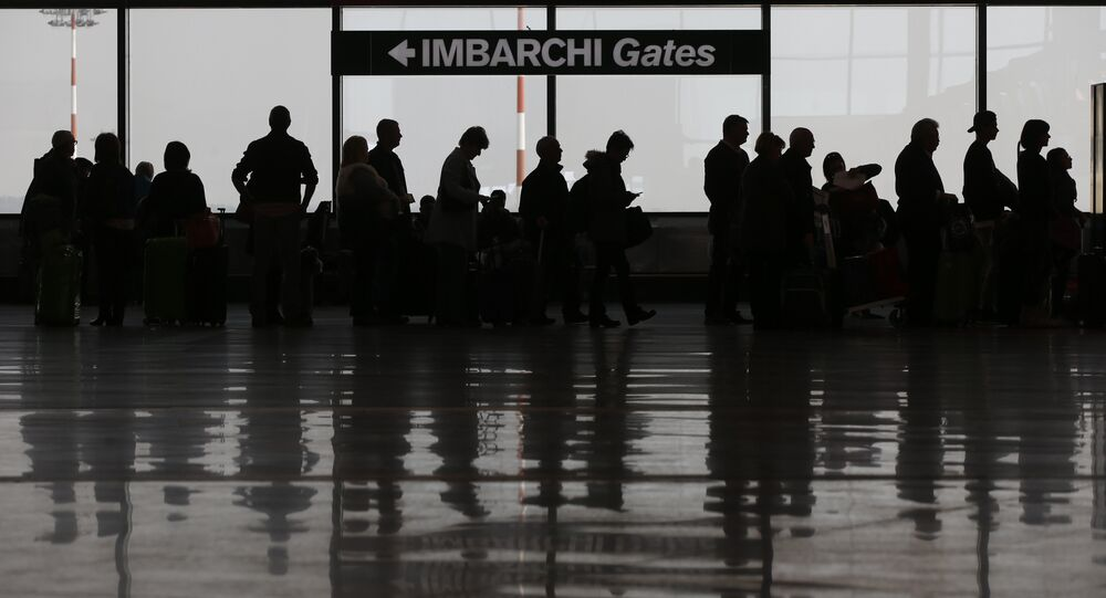 Passengers queue at a check in area of the Milan's Malpensa international airport, in Busto Arsizio, Italy, Tuesday, March 22, 2016