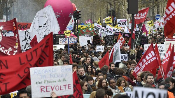 Demonstrators hold banners and signs during a protest on April 9, 2016 at the Place de la Bastille in Paris, against the French government's proposed labour law reforms - Sputnik International