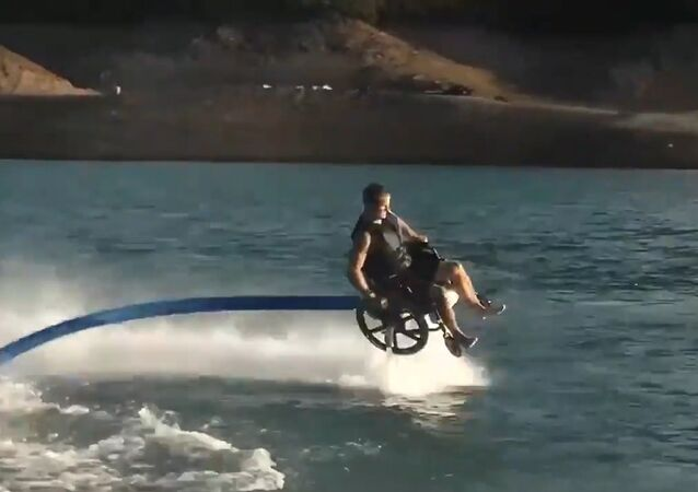 The French online accessibility guide Jaccede.com made a cool video, which shows a man in a wheelchair fly-boarding, doing all sorts of amazing twists and turns.
