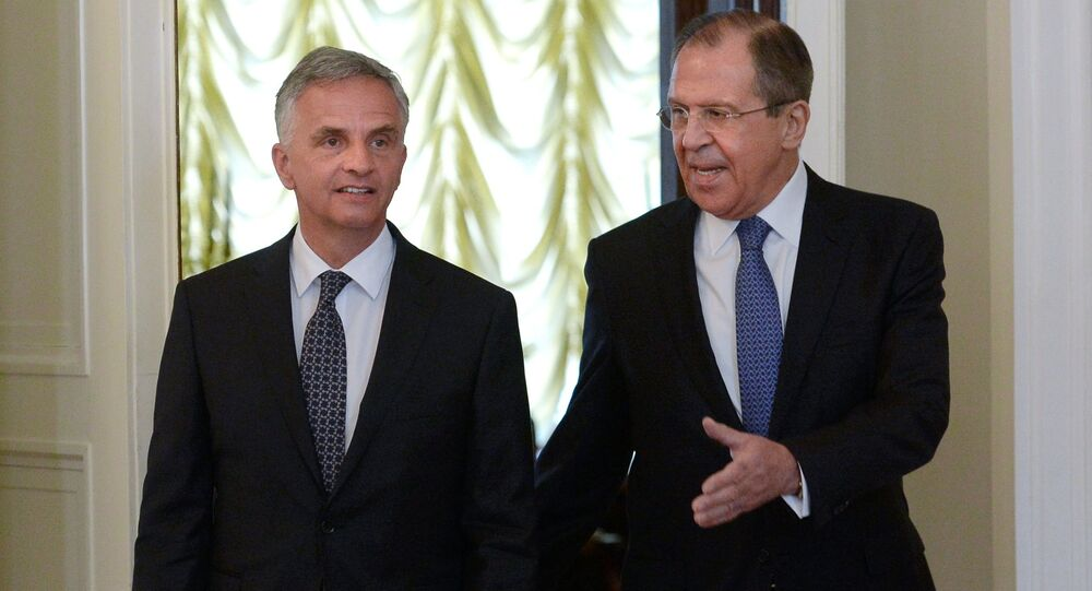 Russian Foreign Minister Sergei Lavrov meets with his Swiss counterpart Didier Burkhalter.