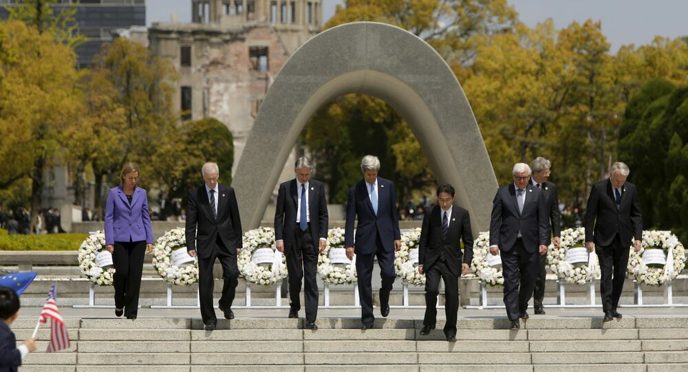 G7 foreign ministers (L to R) EU High Representative for Foreign Affairs Federica Mogherini, Canada's Foreign Minister Stephane Dion, Britain's Foreign Minister Philip Hammond, US Secretary of State John Kerry, Japan's Foreign Minister Fumio Kishida, Germany's Foreign Minister Frank-Walter Steinmeier, Italy's Foreign Minister Paolo Gentiloni and France's Foreign Minister Jean-Marc Ayrault walk together after placing wreaths at the cenotaph at Hiroshima Peace Memorial Park and Museum in Hiroshima, Japan April 11, 2016.