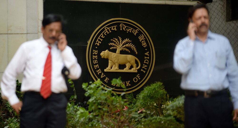 people speak on their mobiles outside the Reserve Bank of India (RBI) headquarters in Mumbai. (File)
