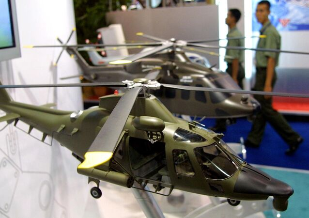 Army personnels walk past models of combat helicopters on display at the Defense Services Asia exhibition in Kuala Lumpur. (File)
