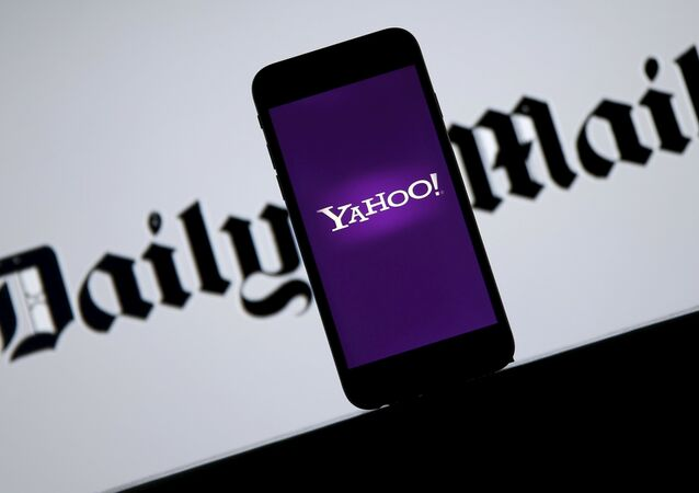 Smartphone with Yahoo logo is seen in front of a displayed Daily Mail logo in this illustration taken April 11, 2016.