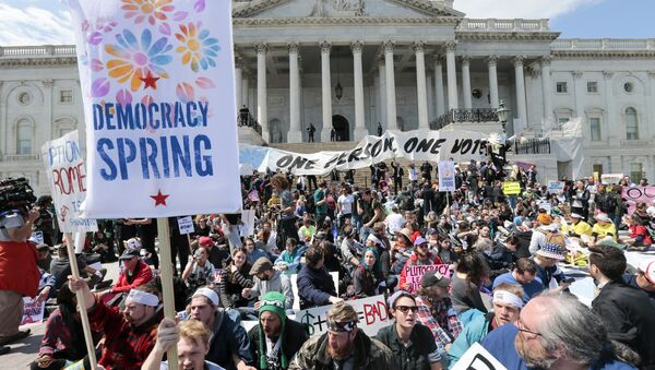 Voting rights reform demonstrators stage a sit-in at the Capitol in Washington, Monday, April 11, 2016, urging lawmakers to take money out of the political process. - Sputnik International