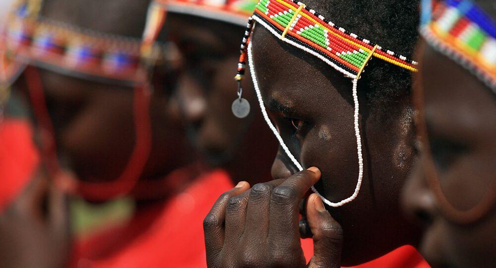 Kenyan teenage Maasai girls attend an alternative right of passage at Kilgoris, Trans Mara district, 220 kilometres north-west of the capital Nairobi, on April 19, 2008 at a ceremony organised by an anti-female genital mutilation, (FGM) campaign, Cherish Others Organisation.