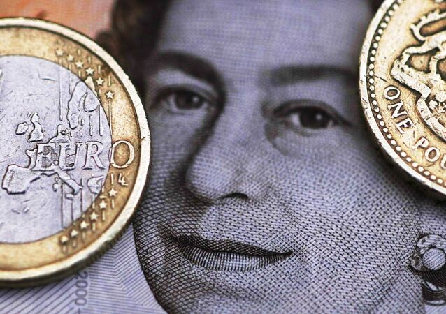 A two Euro coin is pictured next to a one Pound coin on top of a portrait of Britain's Queen Elizabeth in this file photo illustration shot March 16, 2016.